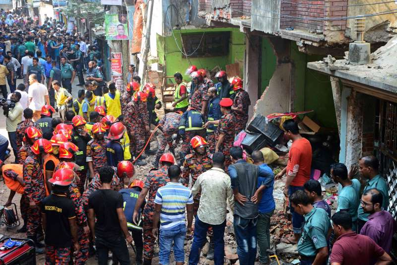 Rescue workers are seen at the site of a gas pipeline explosion in the port city of Chittagong, Bangladesh, on Nov. 17, 2019.