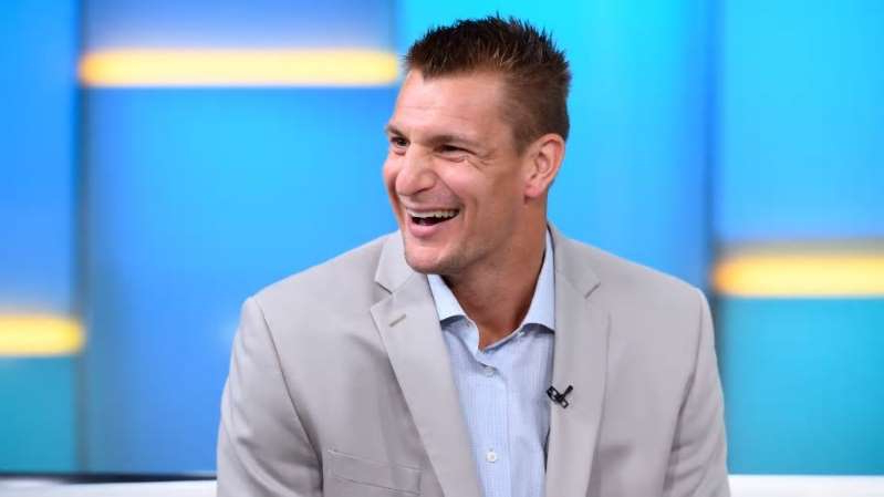 Rob Gronkowski wearing a suit and tie