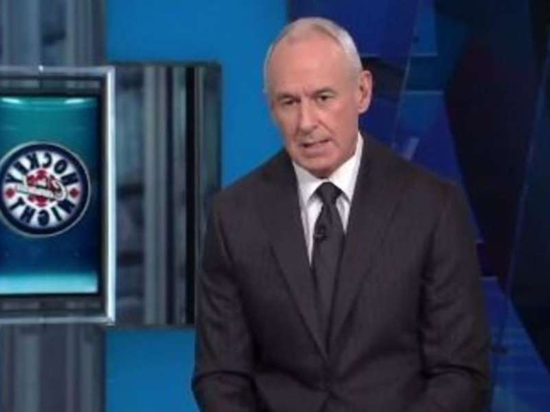 Ron MacLean wearing a suit and tie