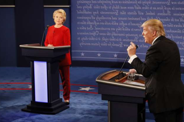 Slide 17 of 30: Democratic nominee Hillary Clinton (R) exchanges with Republican nominee Donald Trump (L) during the first presidential debate at Hofstra University in Hempstead, New York on September 26, 2016. Hillary Clinton and Donald Trump face off in one of the most consequential presidential debates in modern US history with up to 100 million viewers set to tune in. / AFP / POOL / RICK WILKING (Photo credit should read RICK WILKING/AFP/Getty Images)