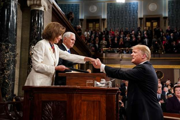 Slide 28 of 30: WASHINGTON, DC - FEBRUARY 5: U.S. President Donald Trump shakes hands with Speaker of the House Nancy Pelosi while joined by Vice President Mike Pence before delivering the State of the Union address in the chamber of the U.S. House of Representatives at the U.S. Capitol Building on February 5, 2019 in Washington, DC. President Trump's second State of the Union address was postponed one week due to the partial government shutdown. (Photo by Doug Mills-Pool/Getty Images)