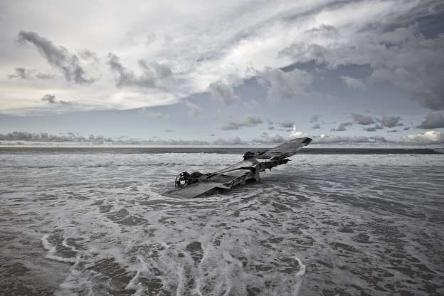 Slide 3 of 28: Eckell discovered the wreck in 2010, six years after the crash. A storm was passing by the day he shot the wreck. Result was the stunning photograph of the plane with heavily overcast sky.