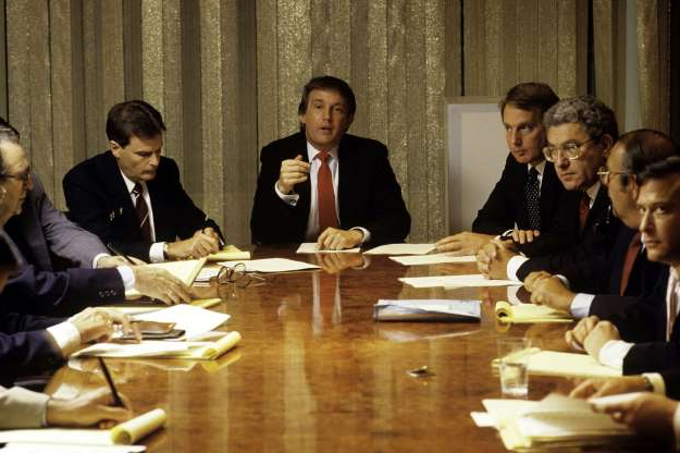 Slide 4 of 30: Donald Trump, real estate mogul, entrepreneur, and billionare spends most of his day attending board meetings in which he manages the construction of his buildings in his offices on August 1987 in New York City.