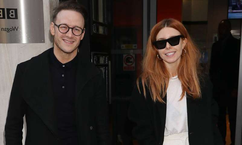 Stacey Dooley, Kevin Clifton are posing for a picture: Hello! Magazine