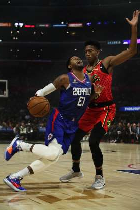 The Los Angeles Clippers' Paul George (13) drives against the Atlanta Hawks' De'Andre Hunter in the first half at Staples Center in Los Angeles on Saturday, Nov. 16, 2019.