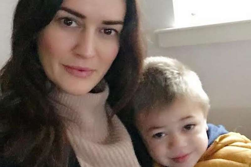 a child posing for the camera: Mason Djemat pictured with his mum Victoria before his tragic death