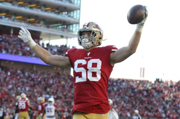 a crowd of people watching a baseball game: San Francisco 49ers tight end Ross Dwelley (82) celebrates after scoring against the Arizona Cardinals during the second half of an NFL football game in Santa Clara, Calif., Sunday, Nov. 17, 2019. (AP Photo/John Hefti)