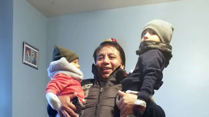 a man and a woman standing in a room: Nazario A. Vazquez, 54, who was killed in the attacks, had befriended homeless men in Chinatown while waiting for buses, his daughter said.
