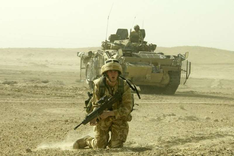 a man in a military vehicle on a dirt road: The year-long investigation claims to have found evidence of beatings, torture and sexual abuse by members of the Black Watch