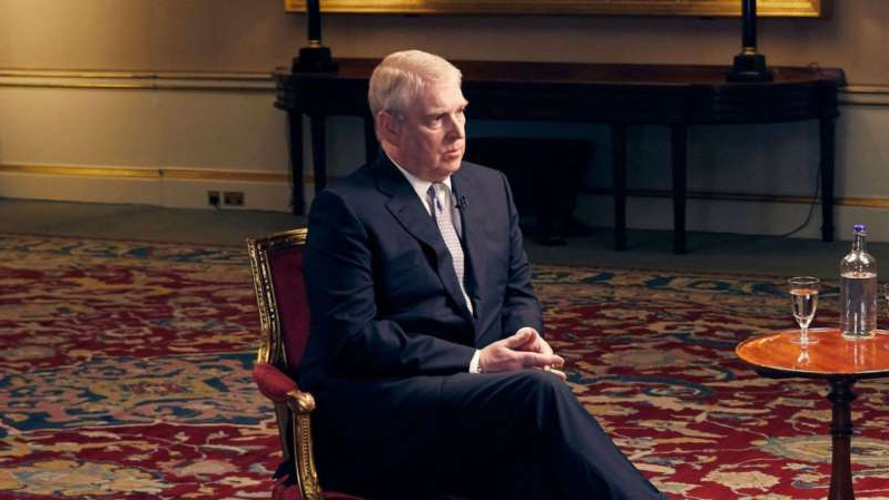 a man wearing a suit and tie sitting in a chair: The Duke of York spoke about his links to Jeffrey Epstein in an interview with BBC Newsnight's Emily Maitlis