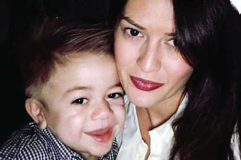 a person posing for the camera: Mason Djemat with his mum Victoria before he tragically died while being treated at the Queen Elizabeth University Hospital in Glasgow