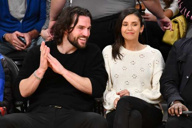 Slide 2 of 47: LOS ANGELES, CALIFORNIA - MARCH 26: Nina Dobrev and Grant Mellon attend a basketball game between the Los Angeles Lakers and the Washington Wizards at Staples Center on March 26, 2019 in Los Angeles, California. (Photo by Allen Berezovsky/Getty Images)