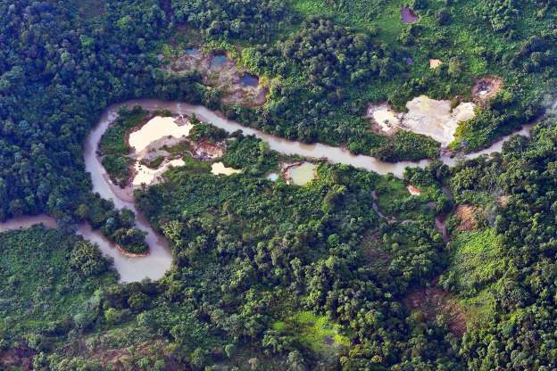 Slide 3 of 25: This aerial view of the Timbiqui River, with signs of the illegal mining of gold, is seen on August 9, 2016  near the municipality of Guapi, departament of Cauca, Colombia.  In a joint operation of the Colombian Armed Forces, two people were captured and 26 excavators and two dredges were destroyed, according to the authorities belonging to the ELN and other organized armed groups. They have calculated that about 18 kilos of gold were extracted daily,  with one kilo of this gold worth approximately 38 thousand dollars. / AFP PHOTO / Luis ROBAYO        (Photo credit should read LUIS ROBAYO/AFP/Getty Images)