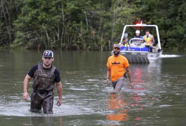 Slide 42 of 54: BEAUMONT, TX - SEPTEMBER 20: Rescue workers navigate the flood waters on highway 124 on September 20, 2019 in Beaumont, Texas. Gov. Greg Abbott has declared much of Southeast Texas disaster areas after heavy rain and flooding from the remnants of Tropical Depression Imelda dumped more than two feet of water across some areas. (Photo by Thomas B. Shea/Getty Images)
