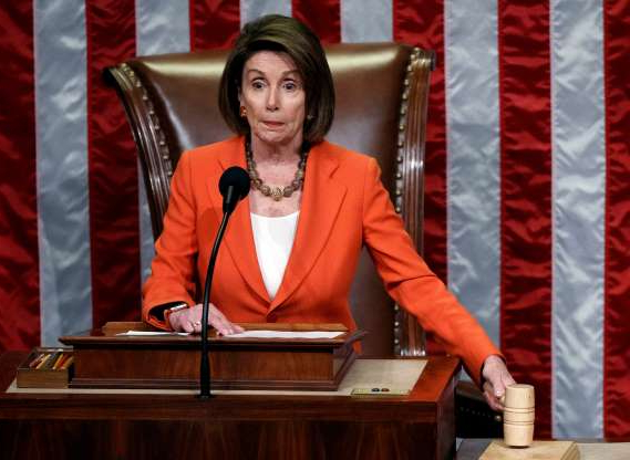 Slide 43 of 55: US Speaker of the House Nancy Pelosi presides over the House vote on a resolution formalizing the impeachment inquiry against US President Donald J. Trump on the House floor in the US Capitol in Washington, DC, USA, 31 October 2019.
