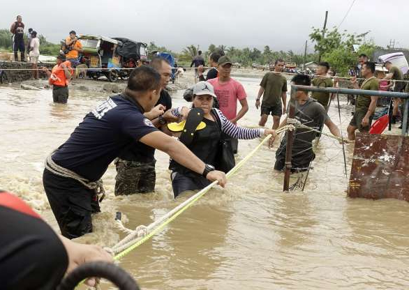 Slide 49 of 54: Mandatory Credit: Photo by LAURENZ CASTILLO/EPA-EFE/Shutterstock (10412646f) Filipino soldiers conduct rescue mission at a flooded village in Zamboanga City, southern Philippines, 13 September 2019. Heavy rain is expected across Philippines, which may cause flooding as tropical depression 'Marilyn' enhances the southwest monsoon, state weather bureau said. The combined effects of 'Marilyn'  and southwest monsoon will bring moderate to intermittent heavy rains in many parts of the country, weather specialist Ariel Rojas said. Flood brought by southwest moonson in Zamboanga City, Philippines - 13 Sep 2019