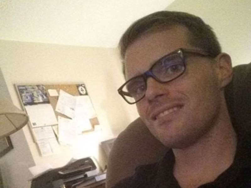 a man wearing glasses and smiling at the camera: Facebook photo of Paul Batchelor