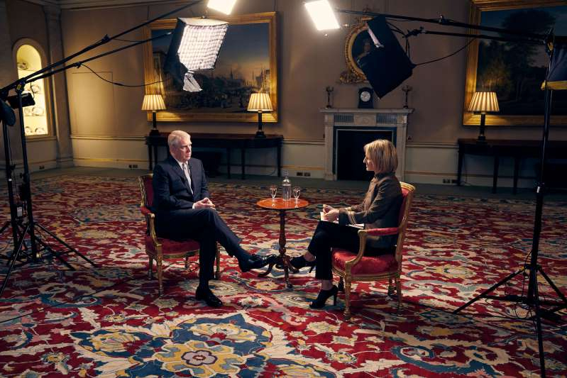 a person sitting in a living room filled with furniture and a rug: The Duke of York speaking about his links to Jeffrey Epstein in an interview with BBC Newsnight's Emily Maitlis (Mark Harrison/BBC)