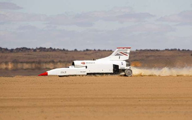 a plane sitting on top of a sandy beach: The British team behind Bloodhound are continuing towards their goal of breaking the world land speed record after the vehicle shot past 600 mph