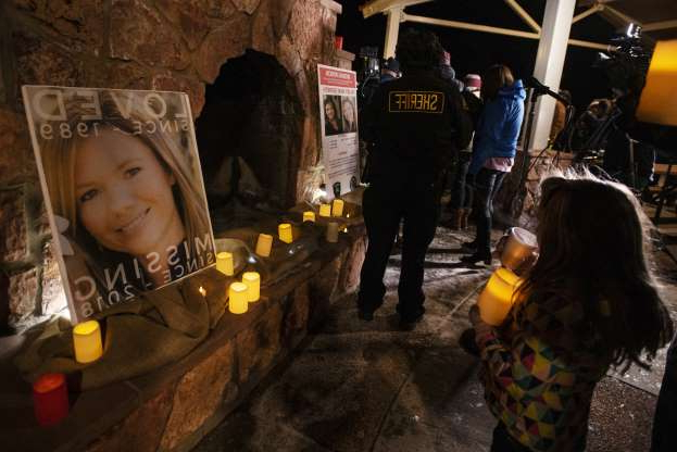 Community members hold a candlelight vigil for Kelsey Berreth under the gazebo of Memorial Park in Woodland Park, Colo., on Thursday, Dec. 13, 2018.
