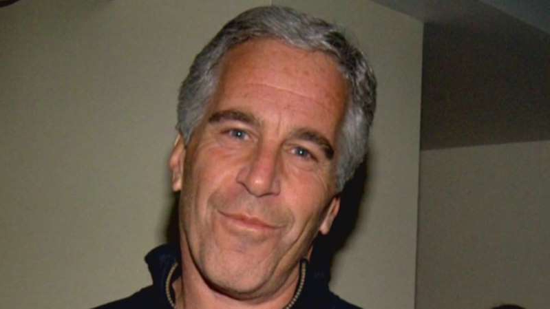 Jeffrey Epstein smiling for the camera