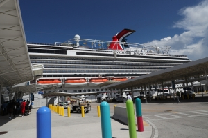 Passenger dies from fall on board Carnival cruise ship, report says