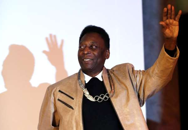 Slide 16 of 18: Brazilian soccer legend Pele poses for picture after receiving an Olympic necklace from President of the International Olympic Committee (IOC) Thomas Bach at the Pele Museum in Santos, Brazil June 16, 2016.