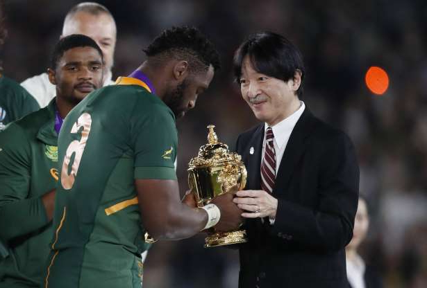 Slide 2 of 100: Rugby Union - Rugby World Cup - Final - England v South Africa - International Stadium Yokohama, Yokohama, Japan - November 2, 2019  South Africa's Siya Kolisi is presented the Webb Ellis trophy by Japan's Crown Prince Akishino after winning the World Cup Final REUTERS/Issei Kato