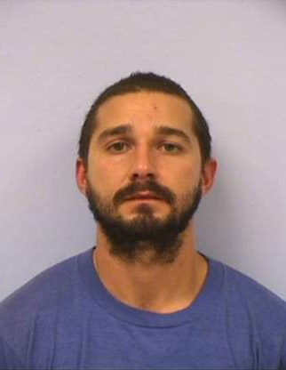 Slide 27 of 113: AUSTIN, TX - OCTOBER 9: In this handout provided by the Austin Police Department, Shia Saide LaBeouf poses for a mugshot photo after he was was arrested for Public Intoxication at the intersection of 6th Street and San Jacinto Boulevard on October 9, 2015 in Austin, Texas. (Photo by Austin Police Department via Getty Images)