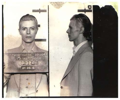 Slide 35 of 113: Music legend David Bowie was arrested in upstate New York in March 1976. (Photo courtesy Bureau of Prisons/Getty Images)