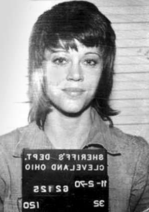 Slide 36 of 113: In this handout, American actress, writer, producer, political activist Jane Fonda in a mug shot following her arrest, Cleveland, Ohio, US, 2nd November 1970. (Photo by Kypros/Getty Images)