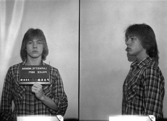 Slide 43 of 113: An 18-year-old Axl Rose posed for the above Lafayette, Indiana police mug shot in July 1980. (Photo courtesy Bureau of Prisons/Getty Images)