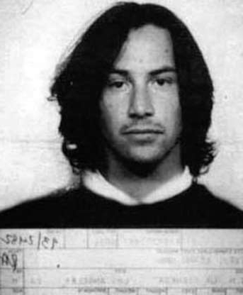 Slide 45 of 113: In this handout, Canadian actor Keanu Reeves in a mug shot following his arrest for driving under the influence, US, 1993. (Photo by Kypros/Getty Images)