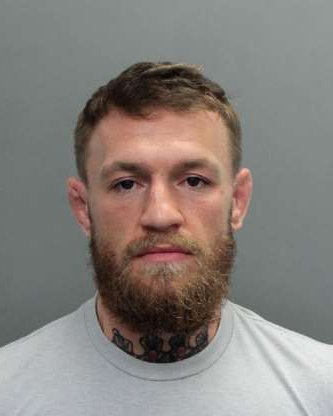 Slide 5 of 113: This photo provided by the Miami-Dade Corrections and Rehabilitation Department shows Conor McGregor. Authorities say mixed martial artist and boxer Conor McGregor has been arrested in South Florida for stealing the cellphone of someone who was trying to take his photo. A Miami Beach police report says the 30-year-old McGregor was arrested Monday, March 11, 2019 and charged with robbery and criminal mischief. (Miami-Dade Corrections and Rehabilitation Department via AP)