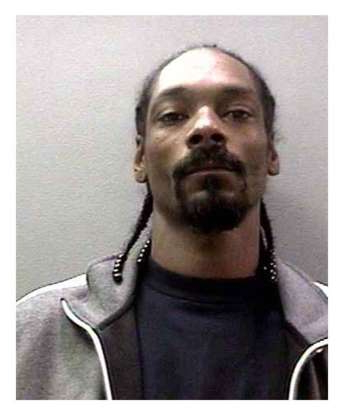 Slide 51 of 113: The rapper Snoop Dogg was booked on a felony charge of possession of a dangerous weapon in November 2006. (Photo courtesy Bureau of Prisons/Getty Images)