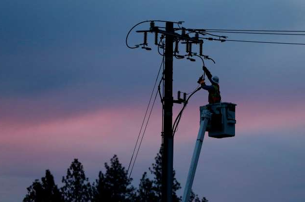 Slide 6 of 17: In this Nov. 26, 2018, file photo, a Pacific Gas & Electric lineman works to repair a power line in fire-ravaged Paradise, Calif. The utility says power could be shut off in 30 counties in central and Northern California starting Wednesday, Oct. 9, when hot weather and strong winds are forecast, and through Thursday.