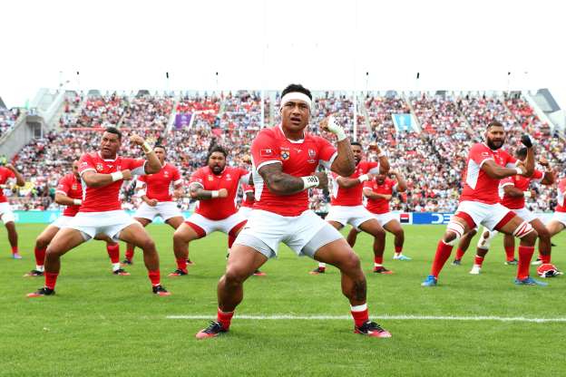 Slide 63 of 100: HIGASHIOSAKA, JAPAN - SEPTEMBER 28: In this handout image provided by the World Rugby, Tonga players perform the Sipi Tau prior to the Rugby World Cup 2019 Group C game between Argentina and Tonga at Hanazono Rugby Stadium on September 28, 2019 in Higashiosaka, Osaka, Japan. (Photo by World Rugby - Handout/World Rugby via Getty Images)