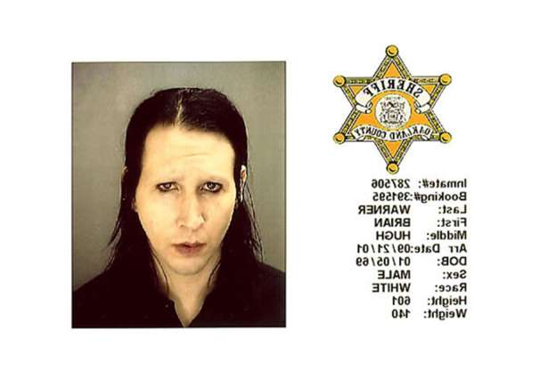 Slide 70 of 113: Brian Hugh Warner (aka Marilyn Manson) was charged with criminal sexual conduct after doing the grind on the head of a security guard during a July 2001 concert in suburban Detroit. (Photo courtesy Bureau of Prisons/Getty Images)