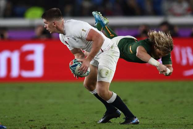 Slide 8 of 100: CAPTION: England's centre Owen Farrell (R) holds the ball past South Africa's scrum-half Faf de Klerk during the Japan 2019 Rugby World Cup final match between England and South Africa at the International Stadium Yokohama in Yokohama on November 2, 2019. (Photo by CHARLY TRIBALLEAU / AFP) (Photo by CHARLY TRIBALLEAU/AFP via Getty Images)