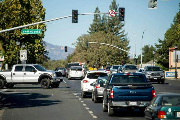Slide 9 of 17: Vehicles back up on Highway 12 as traffic signals remain dark during a power outage on Oct. 9, 2019, in Boyes Hot Springs, Calif.