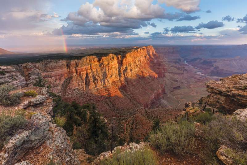a canyon with a mountain in the background: The view from Lipan Point is worth the short detour off the main drive along the South Rim of Grand Canyon National Park.