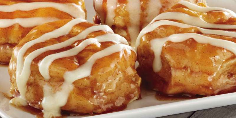 a close up of food: KFC brought back its Cinnabon Dessert Biscuits for a limited time.