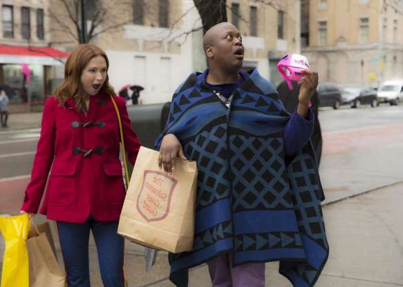 a group of people standing in front of a building: Tina Fey and Ellie Kemper reunite for the final season of Unbreakable Kimmy Schmidt on Netflix.