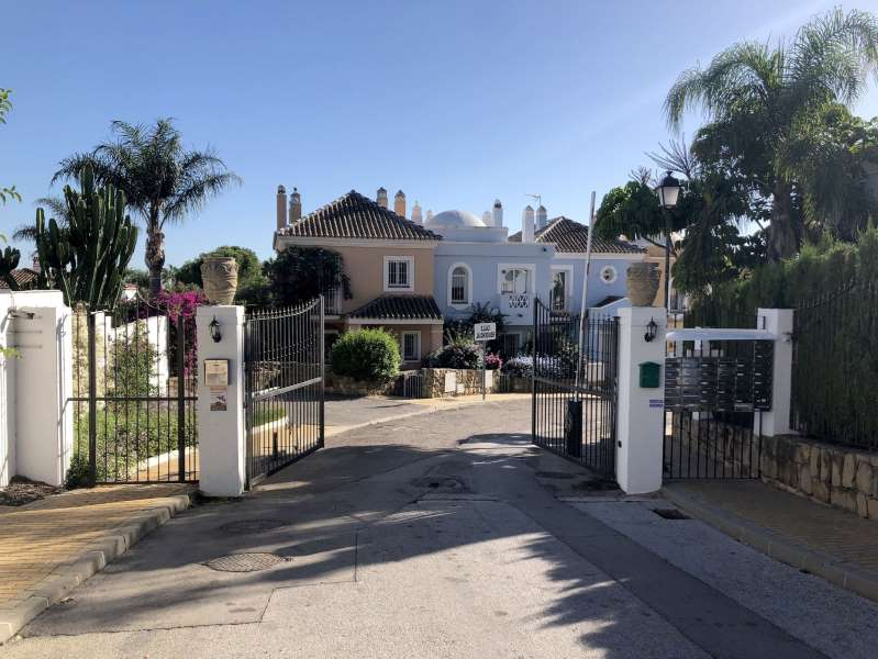 a house in the middle of the street: The gated Aloha Lake Village in Marbella