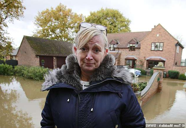 a man standing in front of water: Could close spa: Pam Webb's business, which comprises accommodation, a swimming pool, Jacuzzi and steam room, was devastated, but she will receive no compensation