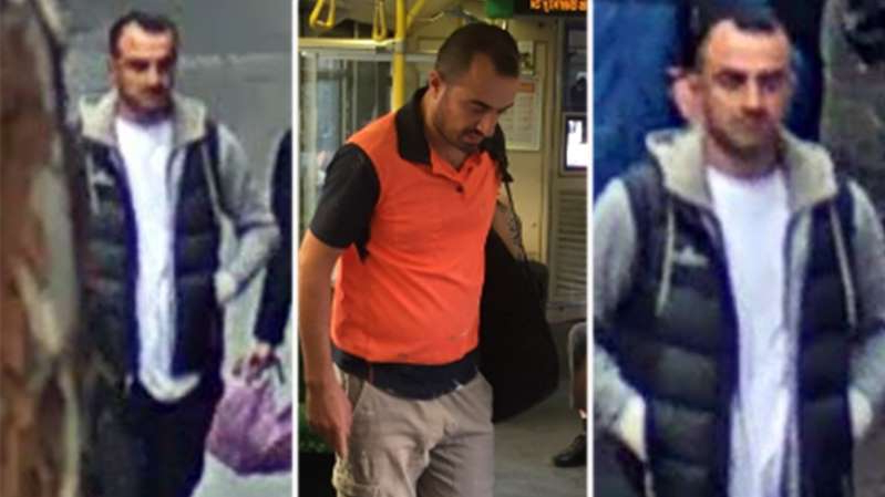 a man standing next to a building: Police believe this man has assaulted a number of women on Melbourne trams.