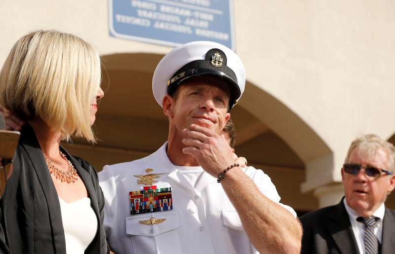 a man wearing a hat: FILE PHOTO: Navy SEAL acquitted of major charges