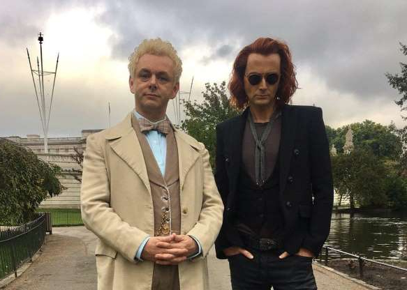 a man wearing a suit and tie: David Tennant and Michael Sheen are a heavenly pair in Amazon's adaptation of Good Omens, the comedic, apocalyptic fantasy novel by Neil Gaiman and the late Terry Pratchett.
