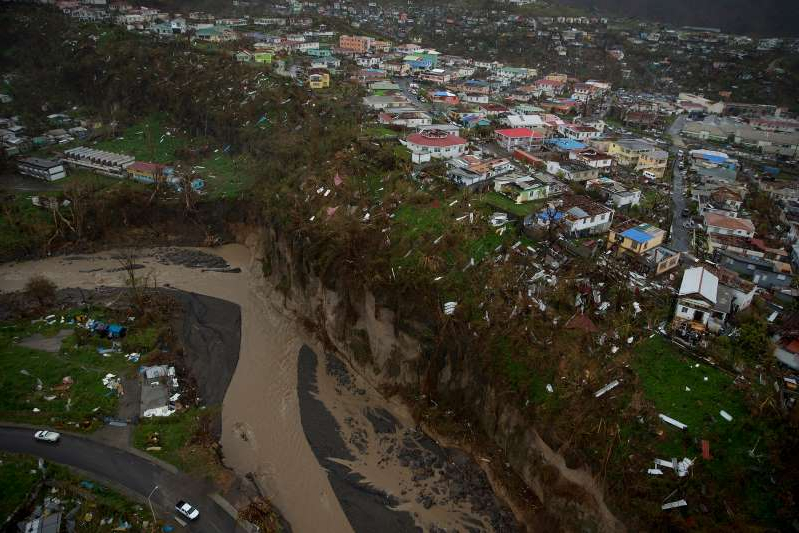 a river running through a city: Ten days after Hurricane Maria struck Dominica, aerial photos showed devastation so complete, it was routinely described as a