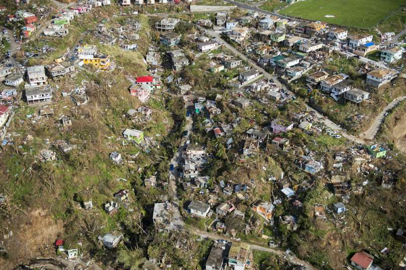 An aerial view of Roseau, capital of the Caribbean island Dominica, shows destruction September 21, 2017, three days after passage of Hurricane Maria.